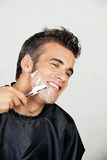 Happy Man Shaving His Face Stock Image
