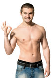 Happy man shirtless showing OK sign Stock Images