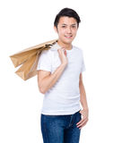 Happy man with shopping bag Royalty Free Stock Image