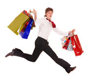 Happy man with shopping bag run. Stock Images