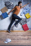 Happy man with shopping bags. Happy young man with shopping bags and new clothes royalty free stock photo