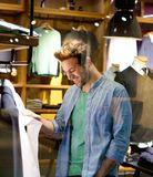 Happy man shopping for clothes at shop. Portrait of a happy man shopping for clothes at shop Stock Images