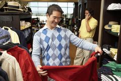 Happy Man Shopping In Clothing Store Stock Images