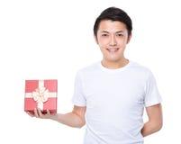 Happy man show with present box Stock Image