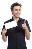 Happy man showing a blank card gesturing thumbs up Royalty Free Stock Photo