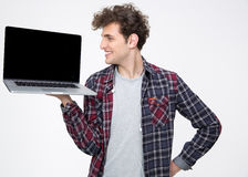 Happy man showing blank laptop screen Royalty Free Stock Image