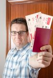 Happy man showing boarding pass and passport Royalty Free Stock Images