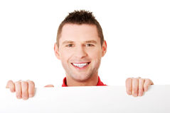 Happy man showing and displaying placard Stock Photography