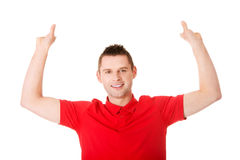 Happy man showing and displaying placard Royalty Free Stock Image