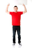 Happy man showing and displaying placard Royalty Free Stock Photos