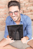 Happy  man showing the empty screen of his tablet pad Stock Image