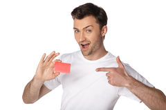 Happy man showing by finger on blank card Stock Images
