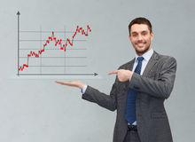Happy man showing forex chart on palm of his hand Stock Photo
