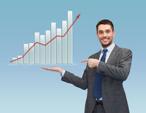 Happy man showing growth chart on palm of his hand Royalty Free Stock Photo