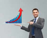 Happy man showing growth chart on palm of his hand Stock Image