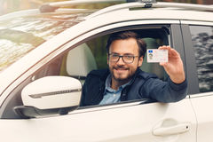 Happy man showing his new driver license Royalty Free Stock Photo