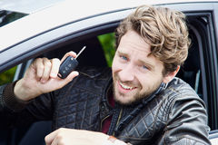 Happy man showing key of new car bought royalty free stock photography