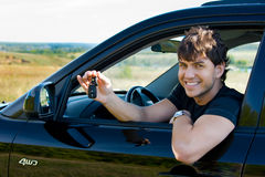 Happy man showing keys from car royalty free stock photography