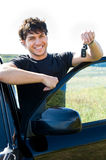 Happy man showing keys near the car Royalty Free Stock Photography