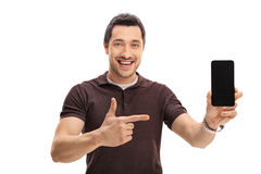 Happy man showing a phone and pointing Royalty Free Stock Photo