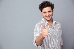 Happy man showing thumb up Stock Photo