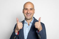 Happy man showing thumbs up. Isolated stock image