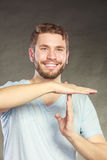 Happy man showing time out gesture sign. Stock Images