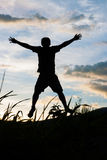 Happy man silhouette. On the sunset Royalty Free Stock Photography
