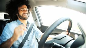 Happy man singing and driving happy stock video footage