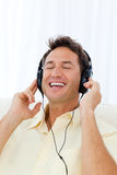 Happy man singing while listening to the music Royalty Free Stock Image