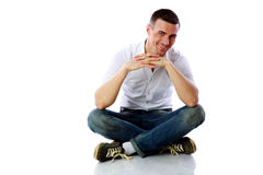 Happy man sitting at the floor Royalty Free Stock Image