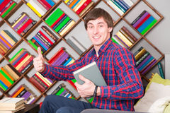 Happy man sitting and holding book. Happy student sitting and holding book Stock Image