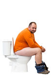 Happy man sitting on toilet Royalty Free Stock Image