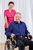 Happy man sitting on wheelchair Royalty Free Stock Images