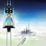 Happy man in sky space elevator concept above city Stock Photography