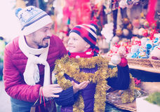 Happy man with small daughter for Christmas outdoors Royalty Free Stock Photos