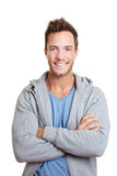 Happy man smiling with arms crossed Stock Photo