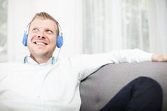 Happy man smiling as he listens to his music Stock Photos