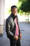 Happy man smiling in black leather jacket Stock Image