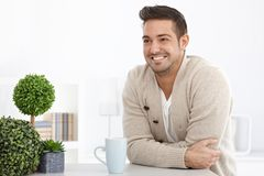 Happy man smiling at home Stock Photo