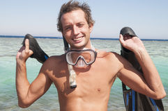 Happy man with snorkel mask and finns Stock Images