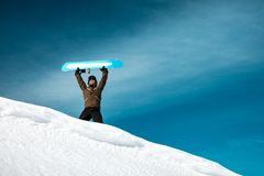 Happy man with snowboard in the mountains royalty free stock photos