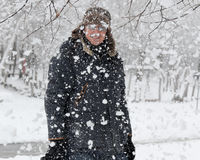 Happy man in snowflakes Stock Photography