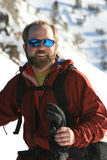 Happy man in snowy mountains Stock Photo