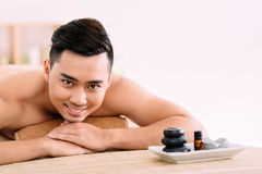 Happy man in spa salon Stock Images