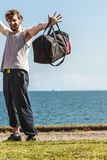 Happy man with sport bag. Stock Images