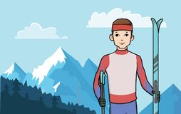 Happy man standing with cross country skis on the background. Young happy man standing with cross country skis on the background of a mountainous landscape Royalty Free Stock Photography