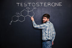 Happy man standing and drawing testosterone molecule chemical structure Stock Images