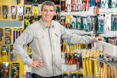 Happy Man Standing In Hardware Store Stock Photos