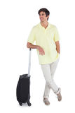 Happy man standing with his suitcase Stock Photos